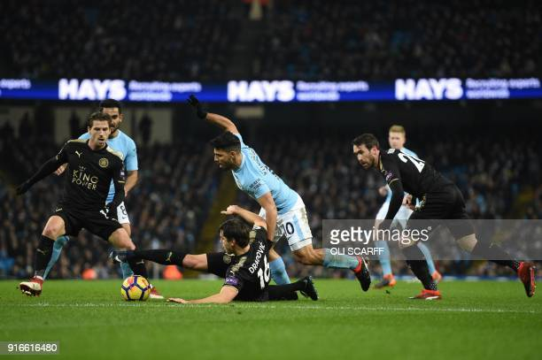 Manchester City's Argentinian striker Sergio Aguero vies with Leicester City's Austrian defender Aleksandar Dragovic during the English Premier...