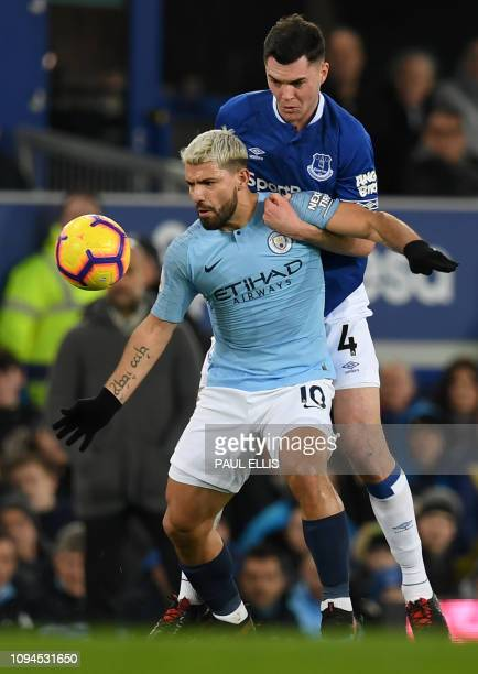 Manchester City's Argentinian striker Sergio Aguero vies with Everton's English defender Michael Keane during the English Premier League football...