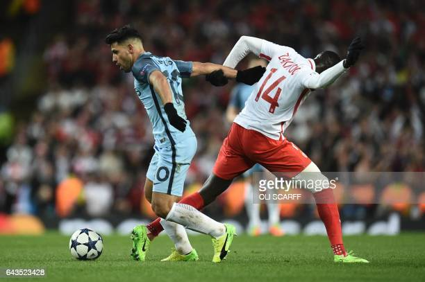 TOPSHOT Manchester City's Argentinian striker Sergio Aguero vies with Monaco's French midfielder Tiemoue Bakayoko during the UEFA Champions League...