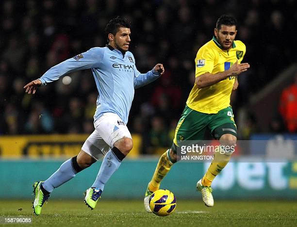 Manchester City's Argentinian striker Sergio Aguero vies with Norwich City's English midfielder Bradley Johnson during the English Premier League...