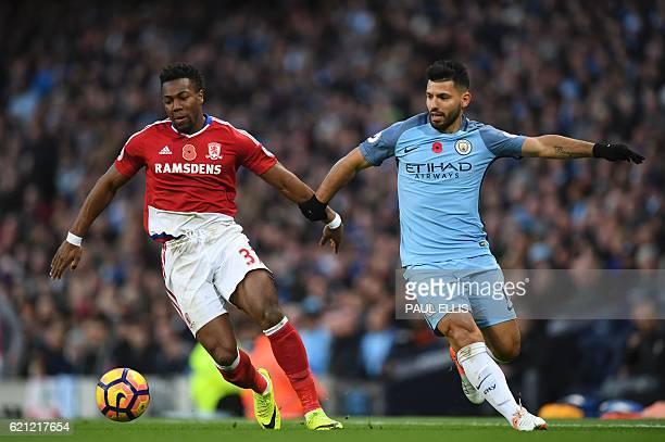 Manchester City's Argentinian striker Sergio Aguero vies with Middlesbrough's Spanish midfielder Adama Traoré during the English Premier League...