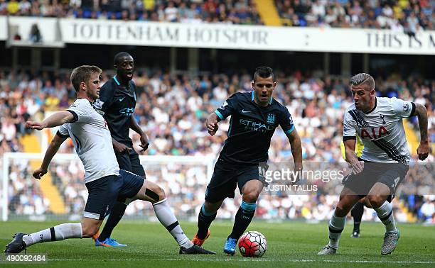 Manchester City's Argentinian striker Sergio Aguero vies with Tottenham Hotspur's Belgian defender Toby Alderweireld and Tottenham Hotspur's English...