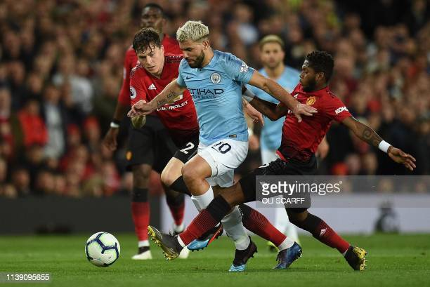 TOPSHOT Manchester City's Argentinian striker Sergio Aguero vies with Manchester United's Swedish defender Victor Lindelof and Manchester United's...