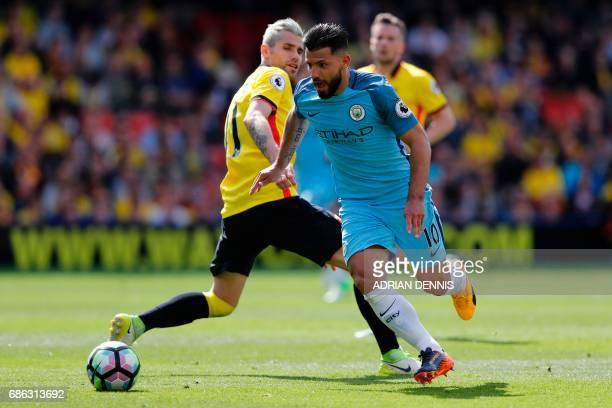 Manchester City's Argentinian striker Sergio Aguero vies with Watford's Yugoslavianborn Swiss midfielder Valon Behrami during the English Premier...