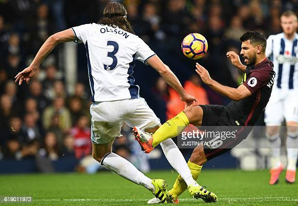 Manchester City's Argentinian striker Sergio Aguero vies with West Bromwich Albion's Swedish defender Jonas Olsson during the English Premier League...