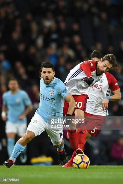 Manchester City's Argentinian striker Sergio Aguero vies with West Bromwich Albion's Polish midfielder Grzegorz Krychowiak during the English Premier...