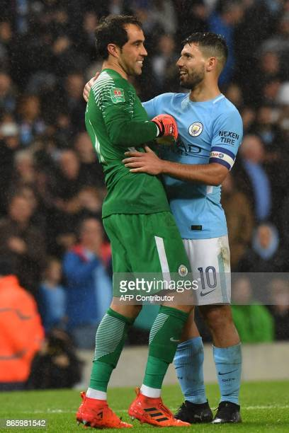 Manchester City's Argentinian striker Sergio Aguero who scored the winning penalty celebrates with Manchester City's Chilean goalkeeper Claudio Bravo...