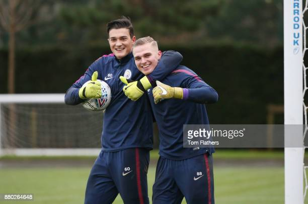 Manchester City's Aro Muric and Pawel Sokol during training at Manchester City Football Academy on November 27 2017 in Manchester England