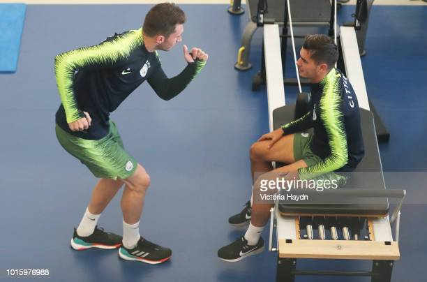 Manchester City's Aymeric Laporte and Ederson Moraes train in the gym at Manchester City Football Academy on August 10 2018 in Manchester England