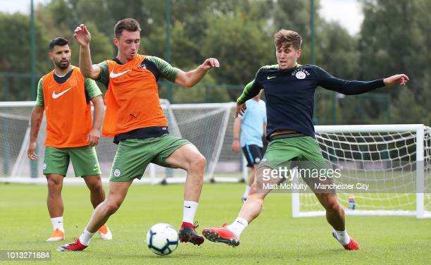Manchester City's Aymeric Laporte and John Stones fight for the ball during training at Manchester City Football Academy on August 8 2018 in...
