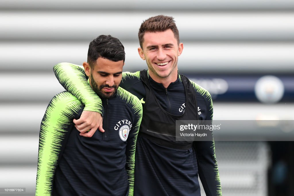 Manchester City's Aymeric Laporte and Riyad Mahrez during training at Manchester City Football Academy on August 10, 2018 in Manchester, England.