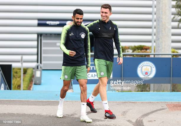 Manchester City's Aymeric Laporte and Riyad Mahrez during training at Manchester City Football Academy on August 10 2018 in Manchester England