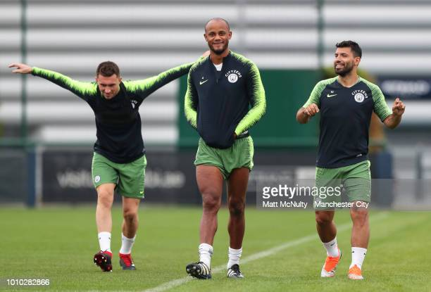 Manchester City's Aymeric Laporte Vincent Company and Sergio Aguero during training at Manchester City Football Academy on August 3 2018 in...
