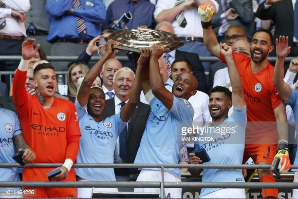 TOPSHOT Manchester City's Belgian defender Vincent Kompany and Manchester City's Brazilian midfielder Fernandinho lift the FA Community Shield as...