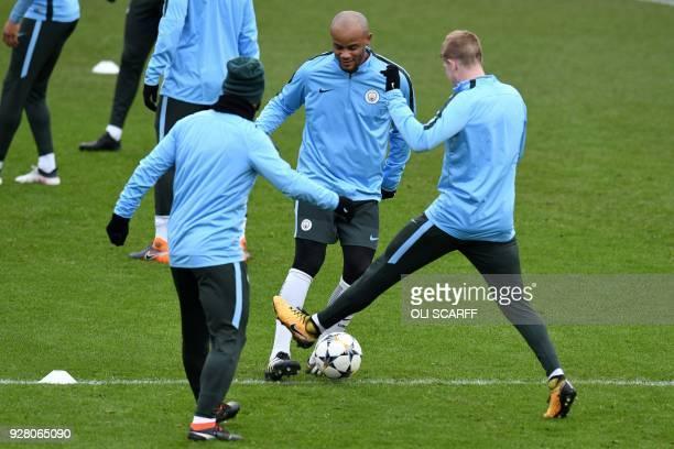 Manchester City's Belgian defender Vincent Kompany and Manchester City's Belgian midfielder Kevin De Bruyne participate in a team training session at...