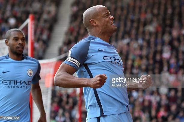 Manchester City's Belgian defender Vincent Kompany celebrates after scoring the opening goal of the English Premier League football match between...