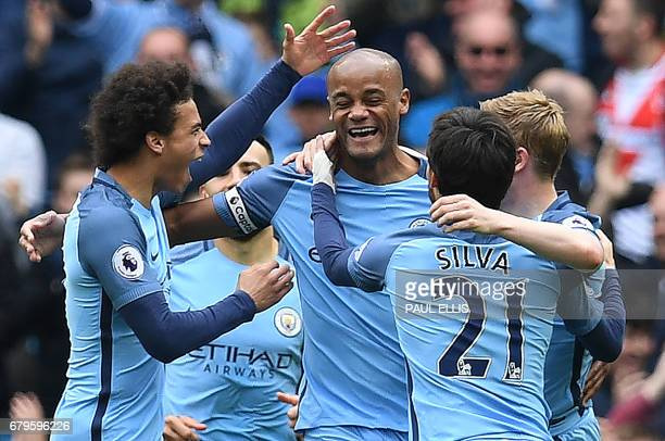 Manchester City's Belgian defender Vincent Kompany celebrates scoring his team's second goal during the English Premier League football match between...