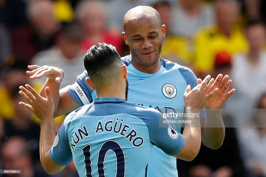 Manchester City's Belgian defender Vincent Kompany (R) celebrates scoring his team's first goal with Manchester City's Argentinian striker Sergio Aguero during the English Premier League football match between Watford and Manchester City at Vicarage Road Stadium in Watford, north of London on May 21, 2017. / AFP PHOTO / Adrian DENNIS / RESTRICTED TO EDITORIAL USE. No use with unauthorized audio, video, data, fixture lists, club/league logos or 'live' services. Online in-match use limited to 75 images, no video emulation. No use in betting, games or single club/league/player publications. /