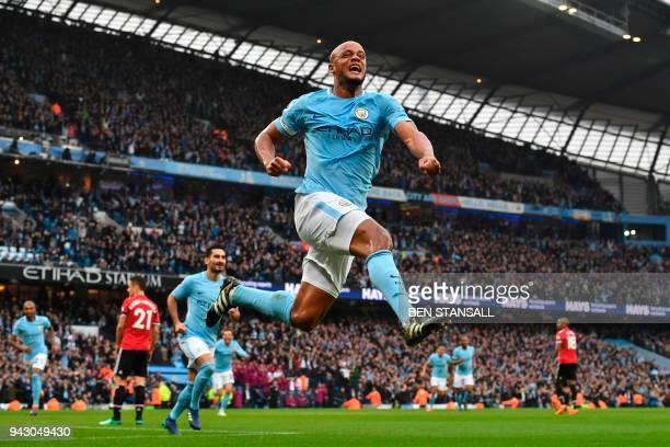 Manchester City's Belgian defender Vincent Kompany celebrates scoring the opening goal during the English Premier League football match between...