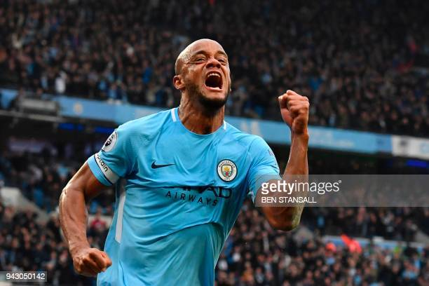 TOPSHOT Manchester City's Belgian defender Vincent Kompany celebrates scoring the opening goal during the English Premier League football match...