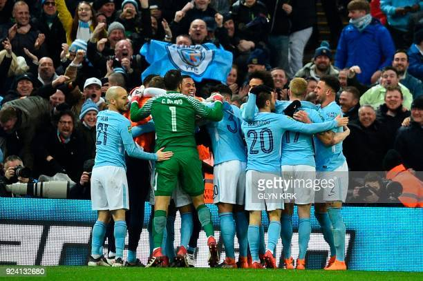 Manchester City's Belgian defender Vincent Kompany celebrates with teammates after scoring their second goal during the English League Cup final...