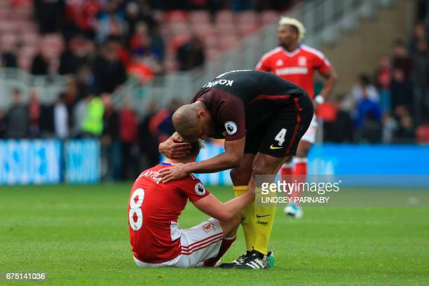 Manchester City's Belgian defender Vincent Kompany commiserates with Middlesbrough's English midfielder Adam Clayton after the draw during the...