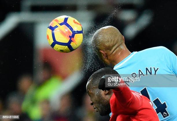 Manchester City's Belgian defender Vincent Kompany heads the ball during the English Premier League football match between Manchester United and...