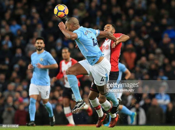 Manchester City's Belgian defender Vincent Kompany heds the ball away from Southampton's English midfielder Nathan Redmond during the English Premier...