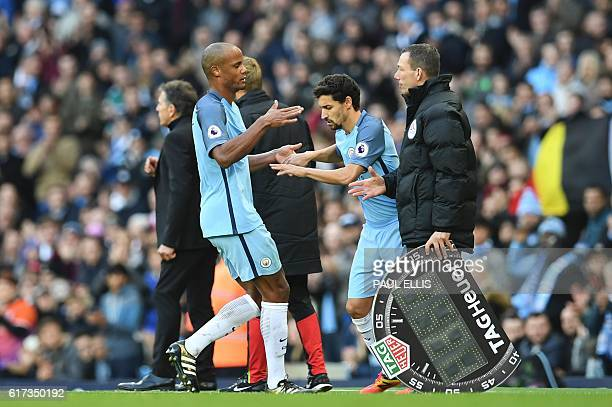 Manchester City's Belgian defender Vincent Kompany is taken off for Manchester City's Spanish midfielder Jesus Navas during the English Premier...