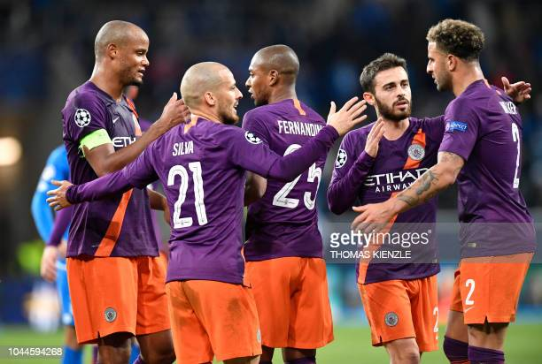 Manchester City's Belgian defender Vincent Kompany Manchester City's Spanish midfielder David Silva Manchester City's Brazilian midfielder...
