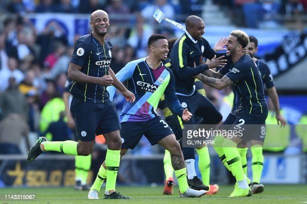 Manchester City's Belgian defender Vincent Kompany Manchester City's Brazilian striker Gabriel Jesus Manchester City's Brazilian midfielder...