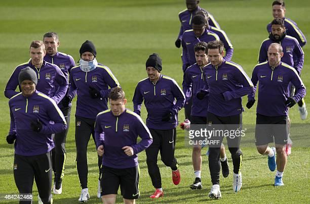 Manchester City's Belgian defender Vincent Kompany Manchester City's English midfielder James Milner lead followed by Manchester City's Bosnian...