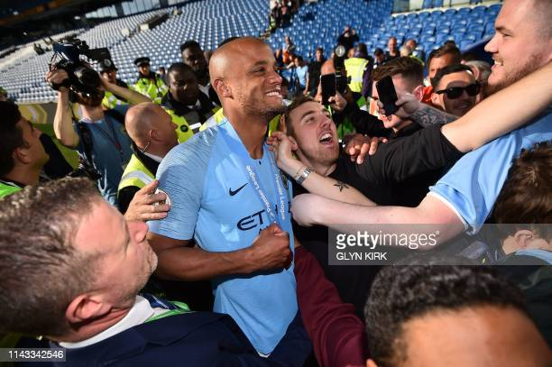 Manchester City's Belgian defender Vincent Kompany mixes with supporters after their 41 victory in the English Premier League football match between...