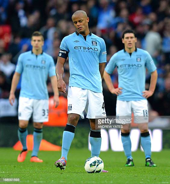 Manchester City's Belgian defender Vincent Kompany reacts after his team loses the English FA Cup final football match between Manchester City and...