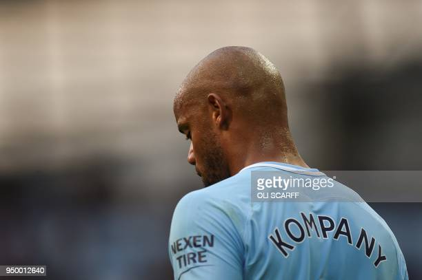 Manchester City's Belgian defender Vincent Kompany reacts during the English Premier League football match between Manchester City and Swansea at the...