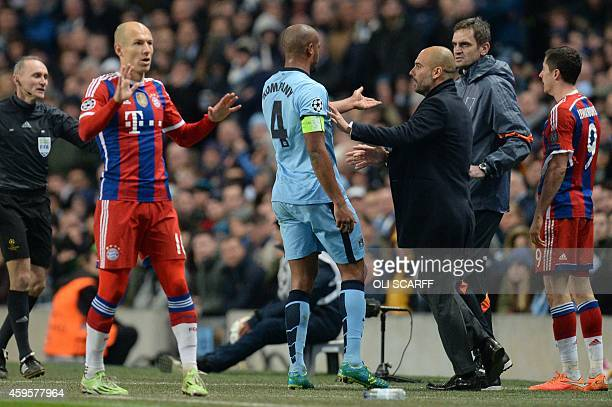 Manchester City's Belgian defender Vincent Kompany remonstrates with Bayern Munich's Spanish head coach Pep Guardiola during the UEFA Champions...