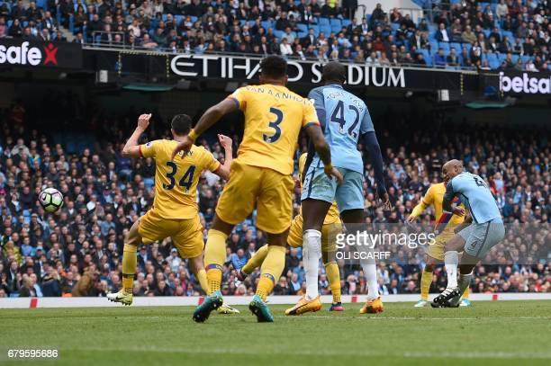 Manchester City's Belgian defender Vincent Kompany scores his team's second goal during the English Premier League football match between Manchester...