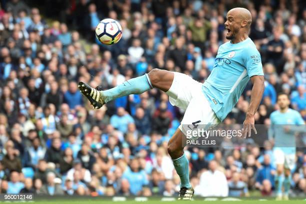 Manchester City's Belgian defender Vincent Kompany shoots but fails to score during the English Premier League football match between Manchester City...