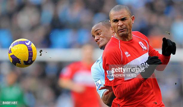 Manchester City's Belgian defender Vincent Kompany vies with Middlesbrough's Brazilian forward Afonso Alves during the English Premier league...