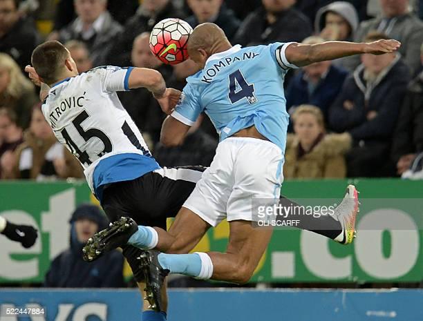 Manchester City's Belgian defender Vincent Kompany vies with Newcastle United's Serbian striker Aleksandar Mitrovic during the English Premier League...