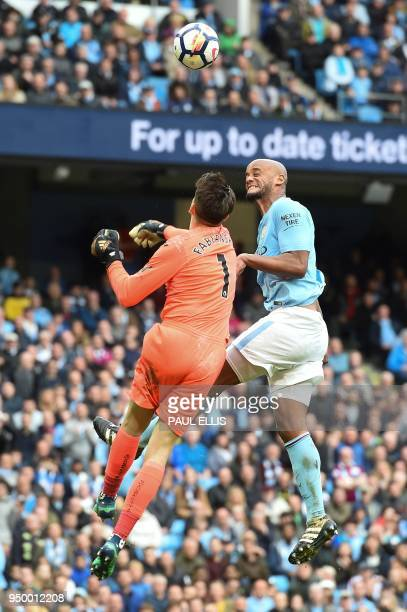 Manchester City's Belgian defender Vincent Kompany vies with Swansea City's Polish goalkeeper Lukasz Fabianski during the English Premier League...