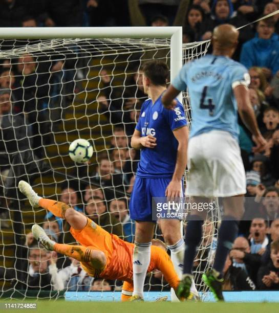 Manchester City's Belgian defender Vincent Kompany watches as his shot beats Leicester City's Danish goalkeeper Kasper Schmeichel to score the...