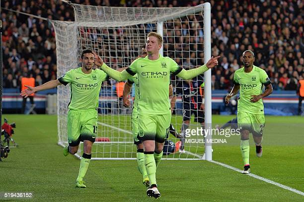 Manchester City's Belgian forward Kevin De Bruyne celebrates with teammates after scoring a goal during the UEFA Champions League quarter final...