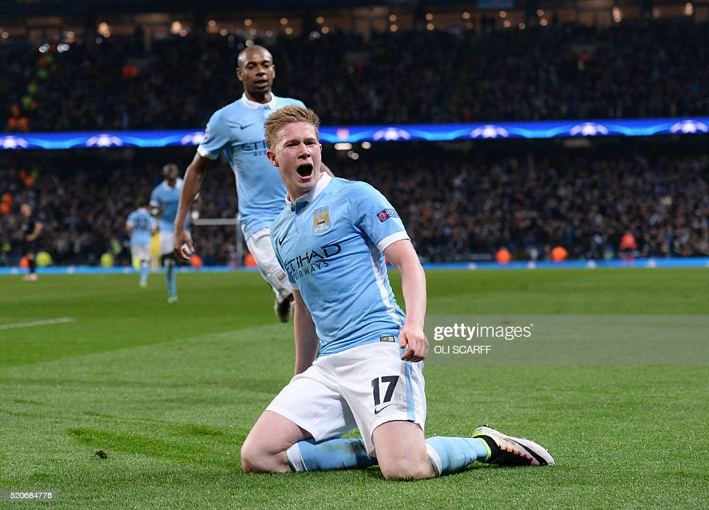 TOPSHOT - Manchester City's Belgian midfielder Kevin De Bruyne celebrates after scoring during the UEFA Champions league quarter-final second leg football match between Manchester City and Paris Saint-Germain at the Etihad stadium in Manchester on April 12, 2016. / AFP / OLI
