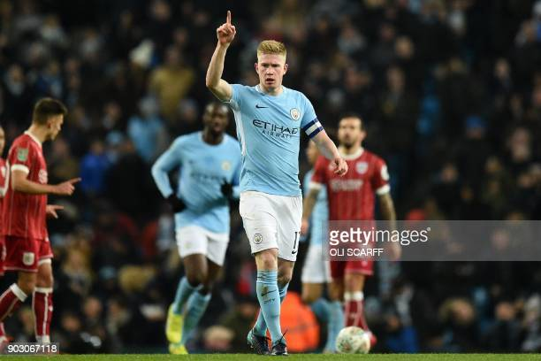 Manchester City's Belgian midfielder Kevin De Bruyne celebrates after scoring their first goal during the English League Cup semifinal first leg...