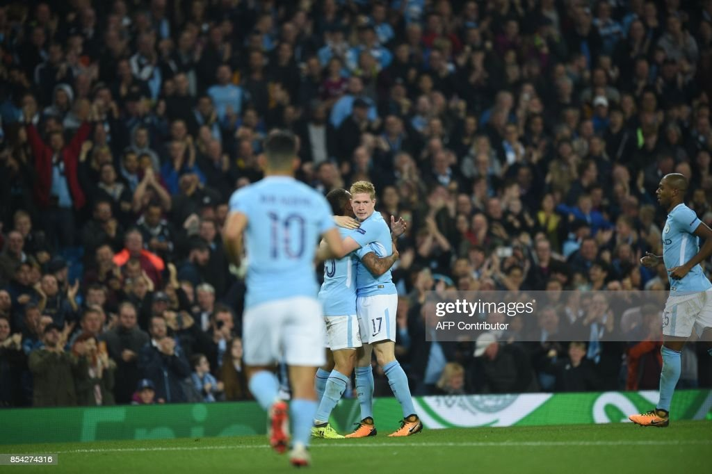 Manchester City's Belgian midfielder Kevin De Bruyne celebrates scoring his team's first goal during the Group F football match between Manchester City and Shakhtar Donetsk at the Etihad Stadium in Manchester, north west England, on September 26, 2017. / AFP PHOTO / Oli SCARFF