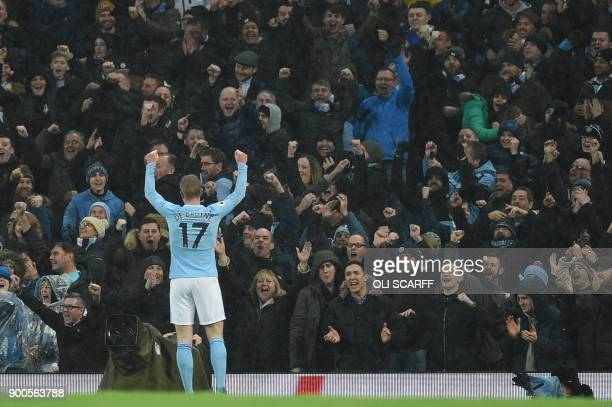 Manchester City's Belgian midfielder Kevin De Bruyne celebrates their second goal during the English Premier League football match between Manchester...