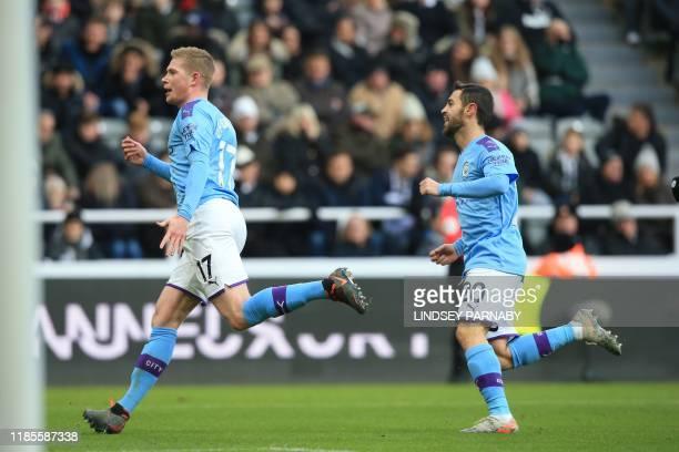 Manchester City's Belgian midfielder Kevin De Bruyne celebrates with Manchester City's Portuguese midfielder Bernardo Silva after scoring his team's...