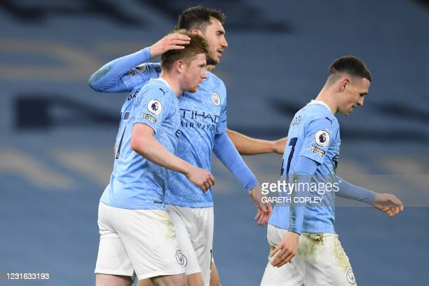 Manchester City's Belgian midfielder Kevin De Bruyne celebrates with teammates after scoring his team's fifth goal during the English Premier League...