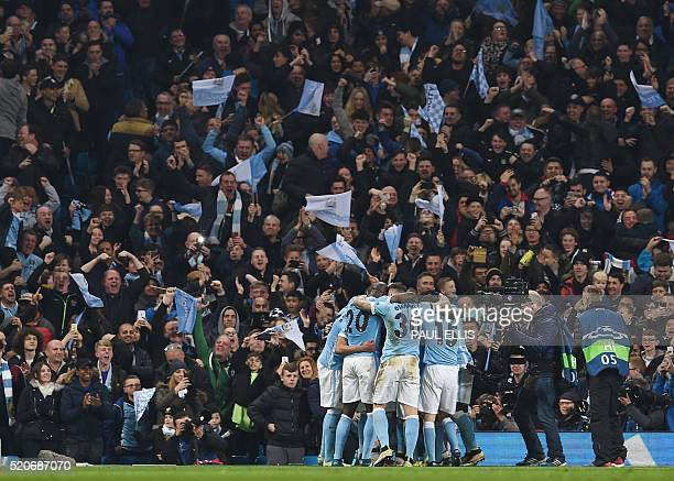 Manchester City's Belgian midfielder Kevin De Bruyne celebrates with teammates after scoring during the UEFA Champions league quarterfinal second leg...
